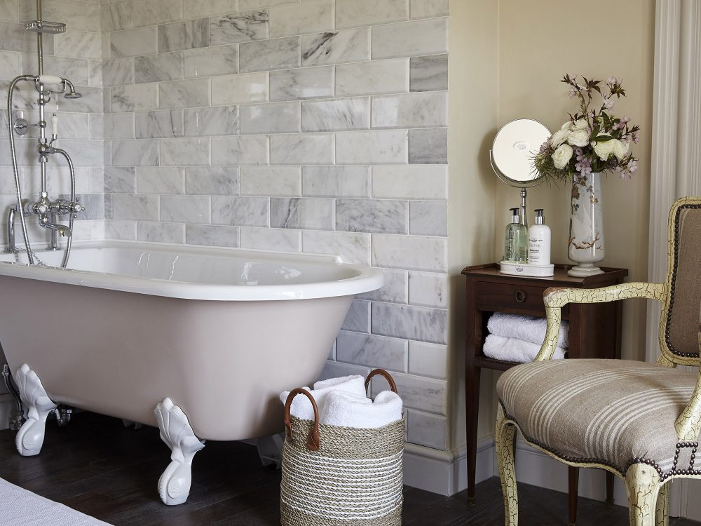 An elegant en-suite bathroom at Goodnestone Park. Interior design & styling by Rowan Plowden Design.