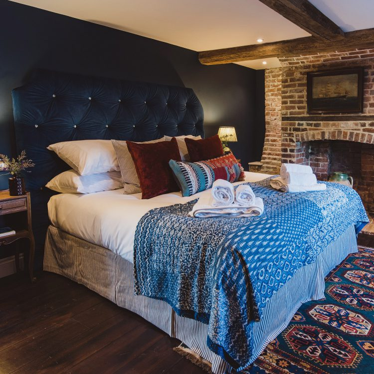 The guest bedroom at Kingshill farmhouse on the Elmley Nature Reserve. Interior design & styling by Rowan Plowden Design.