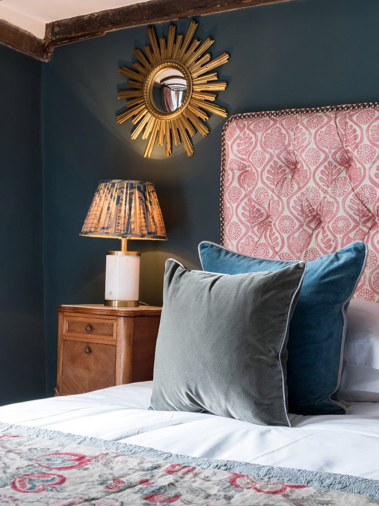 The blue bedroom scatter cushions at Battel Hall. Interior design & styling by Rowan Plowden Design.