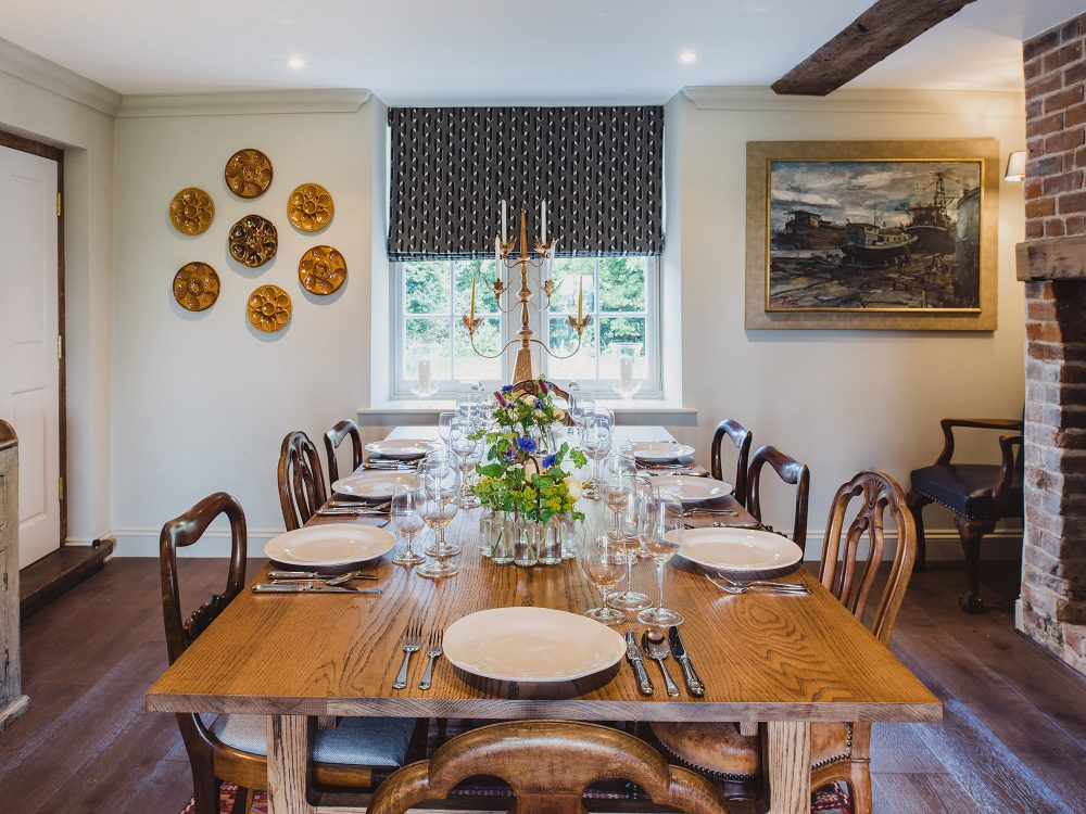 Dining room at Kingshill farmhouse on the Elmley Nature Reserve. Interior design & styling by Rowan Plowden Design.