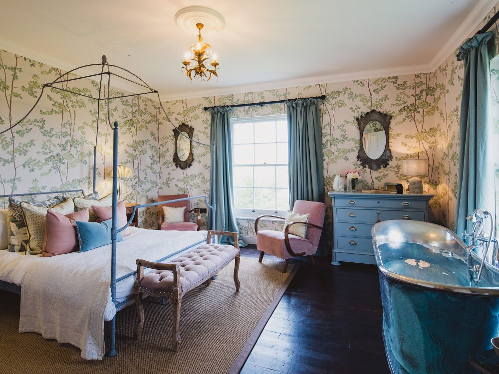 The master bedroom at Kingshill farmhouse on the Elmley Nature Reserve. Interior design & styling by Rowan Plowden Design.