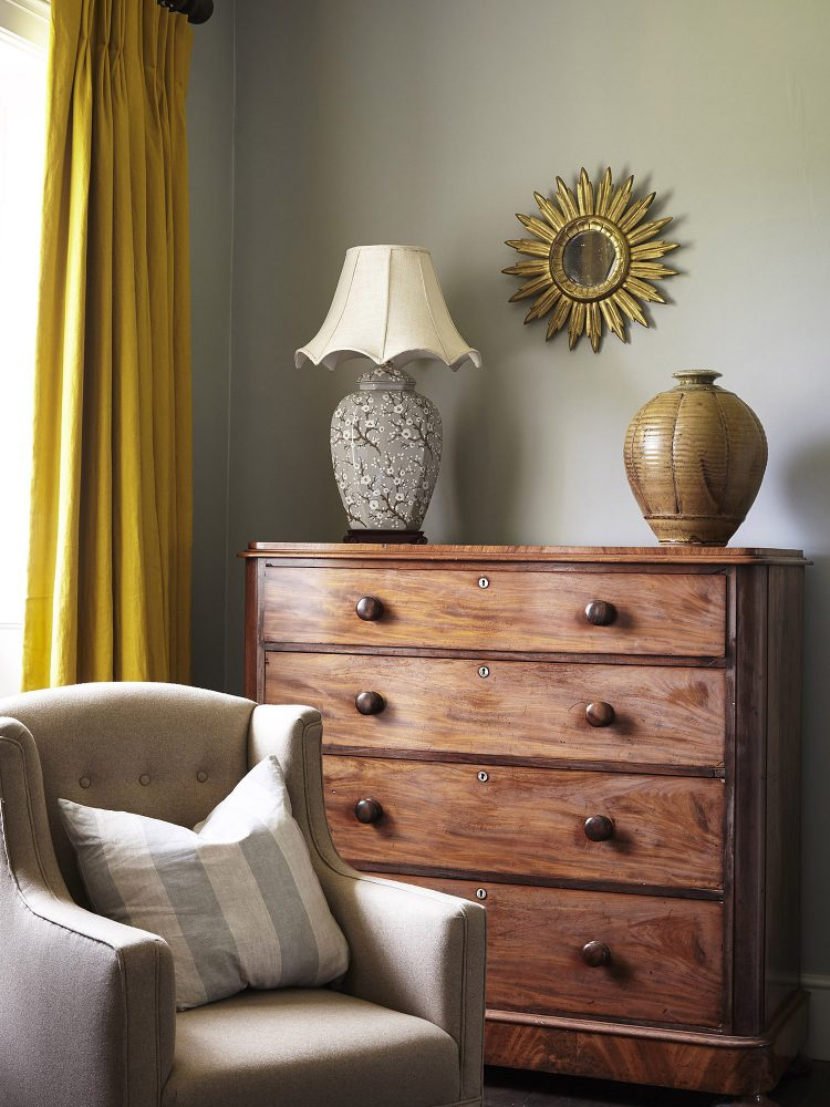An oak chest of drawers at Goodnestone Park. Interior design & styling by Rowan Plowden Design.
