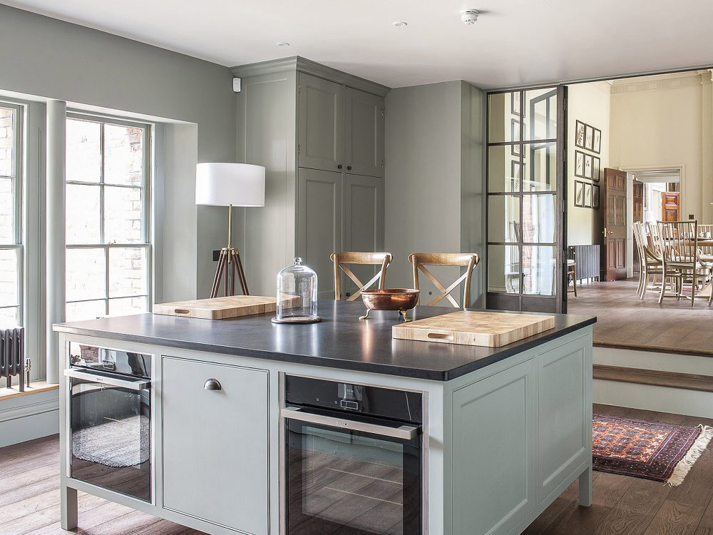 The kitchen island at Goodnestone Park. Interior design & styling by Rowan Plowden Design.
