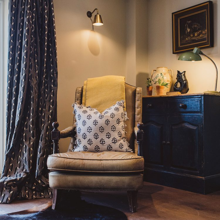 Old leather chair at Kingshill farmhouse on the Elmley Nature Reserve. Interior design & styling by Rowan Plowden Design.