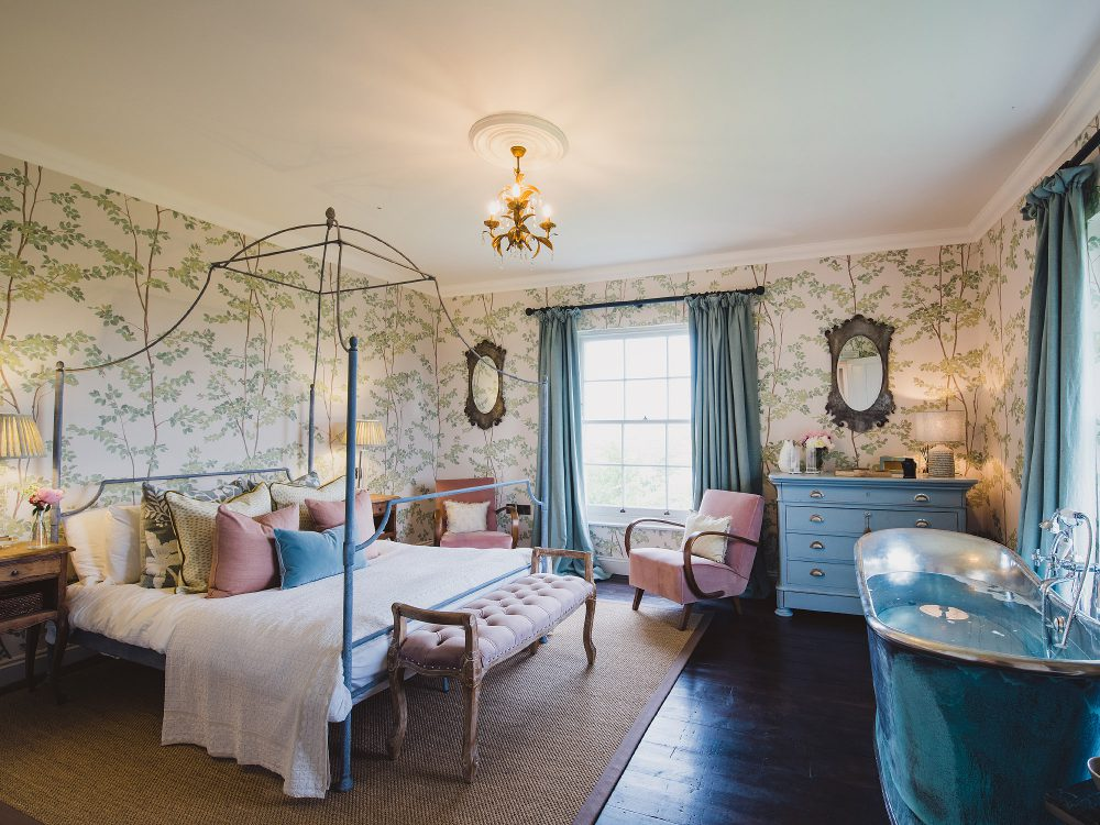 Master bedroom at Kingshill farmhouse on the Elmley Nature Reserve. Interior design & styling by Rowan Plowden Design.