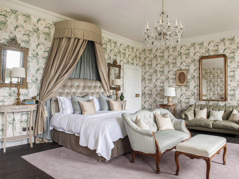 The master bedroom at Goodnestone Park. Interior design & styling by Rowan Plowden Design.
