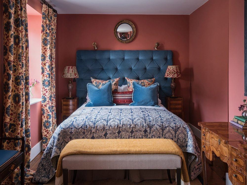 Red guest bedroom at Battel Hall. Interior design & styling by Rowan Plowden Design.
