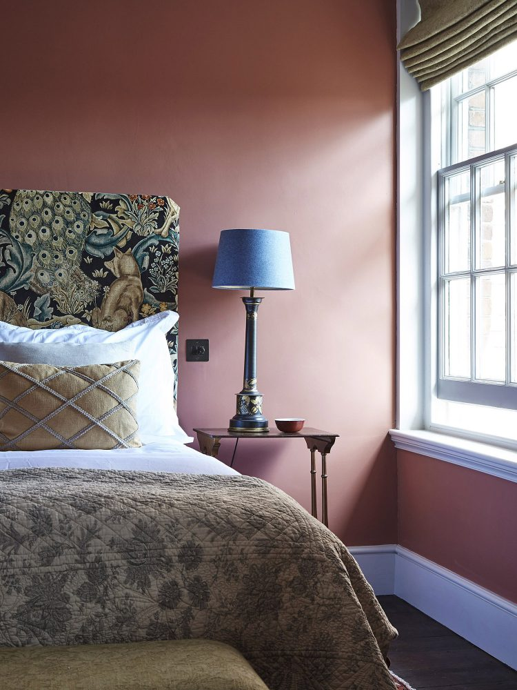 The red bedroom at Goodnestone Park. Interior design & styling by Rowan Plowden Design.