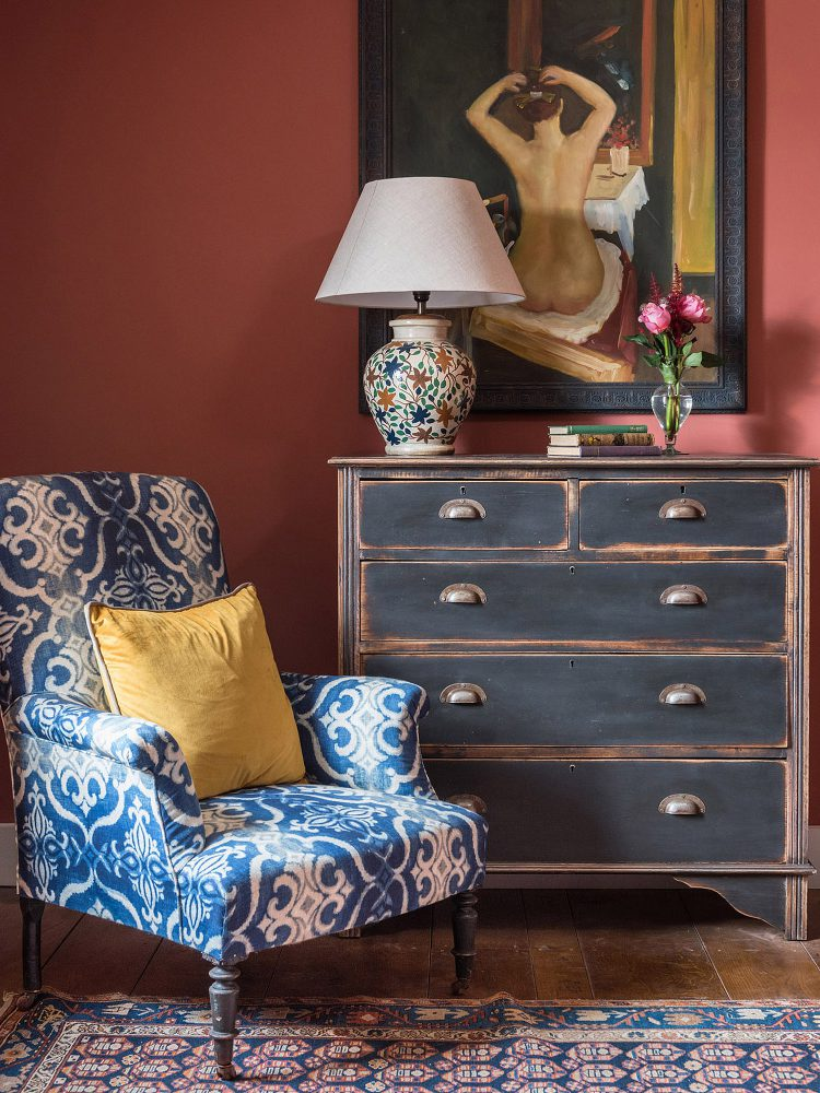 Elegant blue and white chair at Battel Hall. Interior design & styling by Rowan Plowden Design.
