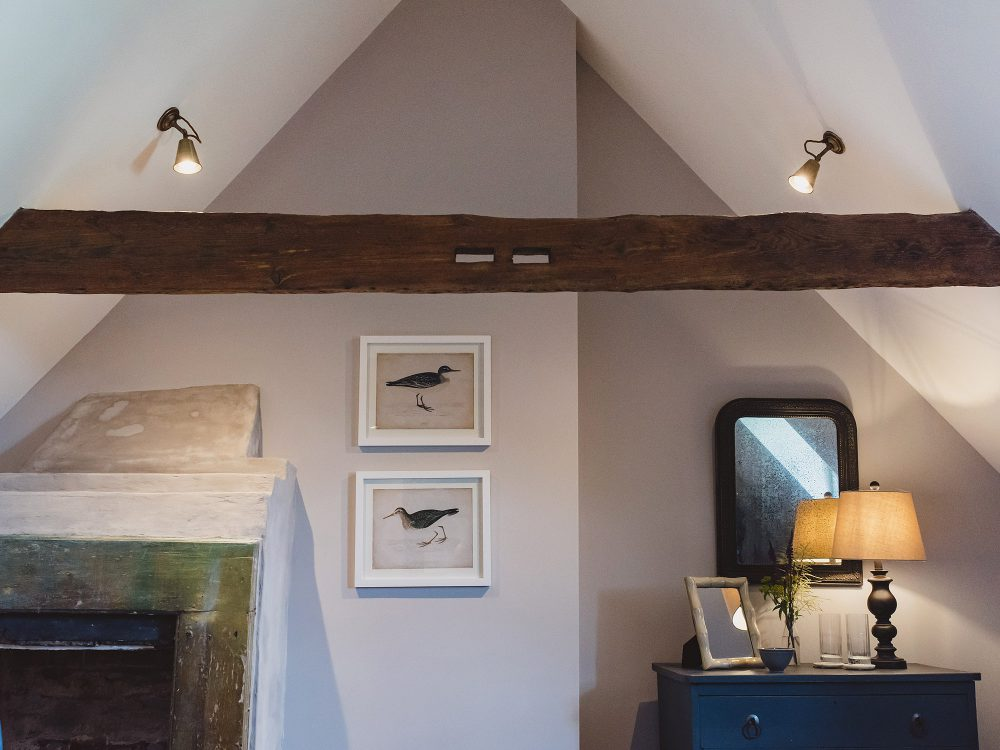 Exposed beams at Kingshill farmhouse on the Elmley Nature Reserve. Interior design & styling by Rowan Plowden Design.