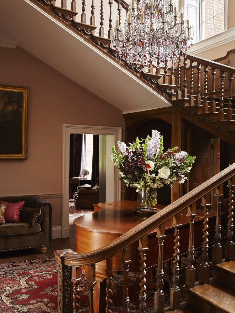 The red staircase at Goodnestone Park. Interior design & styling by Rowan Plowden Design.