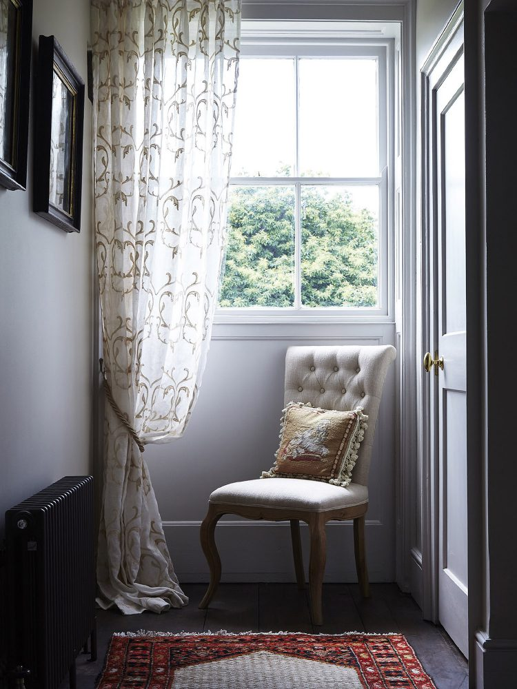 An elegant chair at Goodnestone Park. Interior design & styling by Rowan Plowden Design.