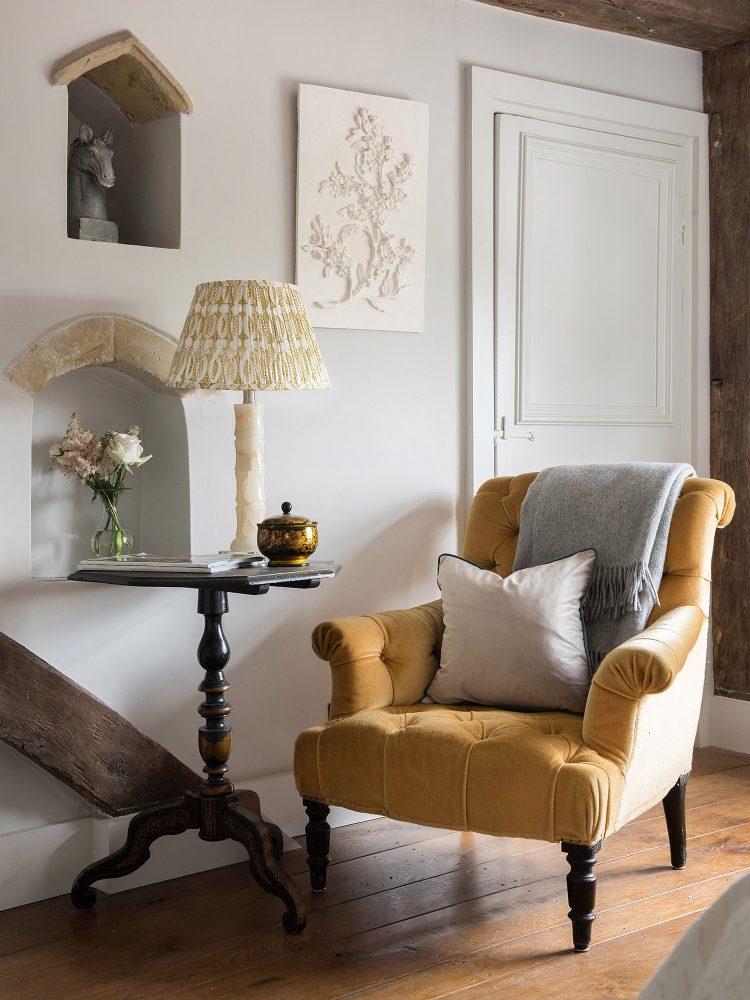 Single yellow chair at Battel Hall. Interior design & styling by Rowan Plowden Design.
