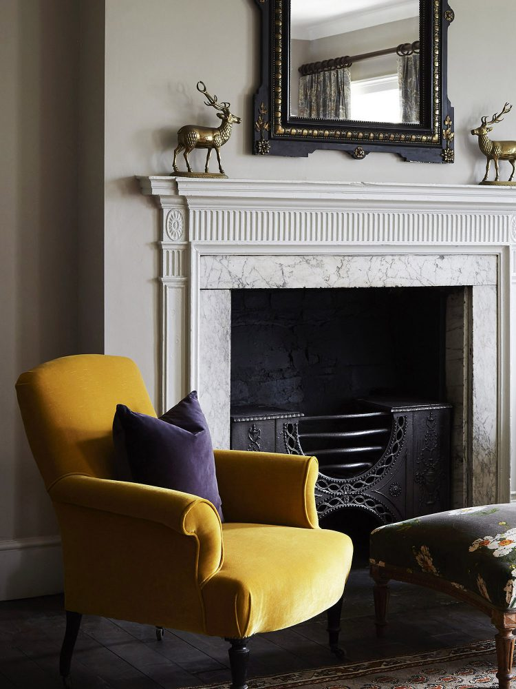 A single yellow chair at Goodnestone Park. Interior design & styling by Rowan Plowden Design.