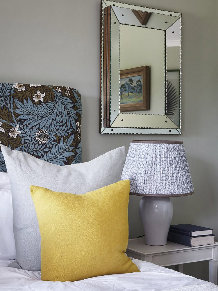 Yellow throw cushions at Goodnestone Park. Interior design & styling by Rowan Plowden Design.